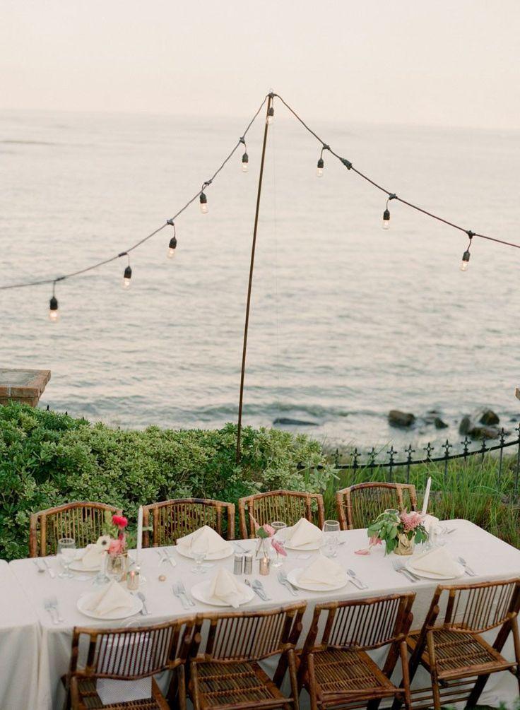 Wedding Reception Overlooking the Ocean with String Lights https://www.thecelebrationsociety.com/weddings/trendy-stylish-gold-pink-wedding-villa-de-suenos-st-simons-island-ga/