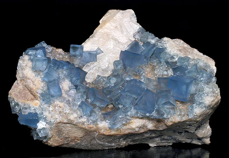 Pretty Specimen Of Blue Fluorite Cubes With A Barite Blade