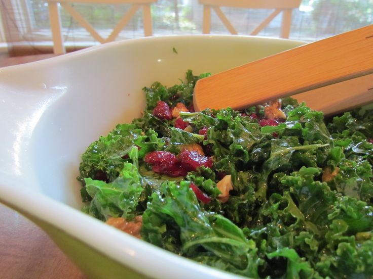 Ever tried the Whole Foods kale salad at their deli?  This looks like the perfect knockoff!  If you want to try raw kale, this is a good, easy way to have it:  raw kale, lemon juice, liquid stevia (optional), olive oil, dried cranberries, and pine nuts or walnuts