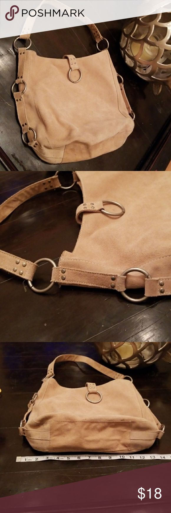 🦄100% COW LEATHER TOTE SILVER RINGS Absolutely stunning tan leather bag with silver rings adorning. Great condition. Pockets inside.    Also CHECK OUT my  🦄3 for $15🦄, 💋3 for $24💋 &♥️10 for $10♥️ SALE!  Why SHOP MY Closet? 💋Smoke/ Pet Free 💋OVER 1000 🌟🌟🌟🌟🌟RATINGS 💋POSH AMBASSADOR &TOP 10% Seller  💋TOP RATED 💋 FAST SHIPPER  💋BUNDLES DISCOUNT 💋EARN VIP DOLLARS W/ EVERY PURCHASE ❤HAPPY POSHING!!! 💕 Old Navy Bags