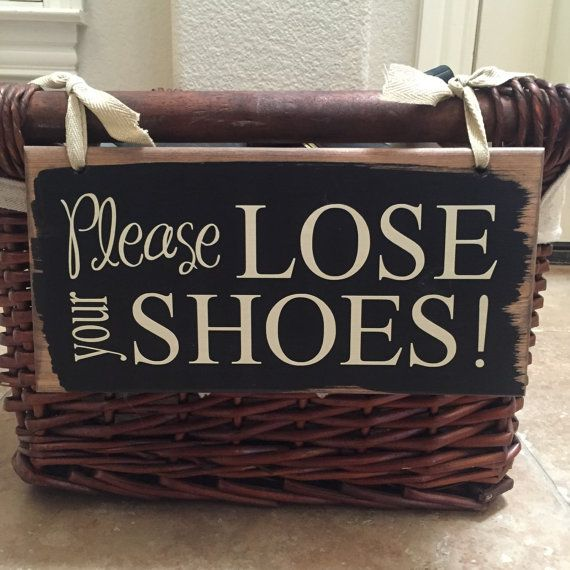 Adorable way to let your guests know they need to remove their shoes! Cute sign measures approx. 5 1/4x11 and comes with two holes on top ready