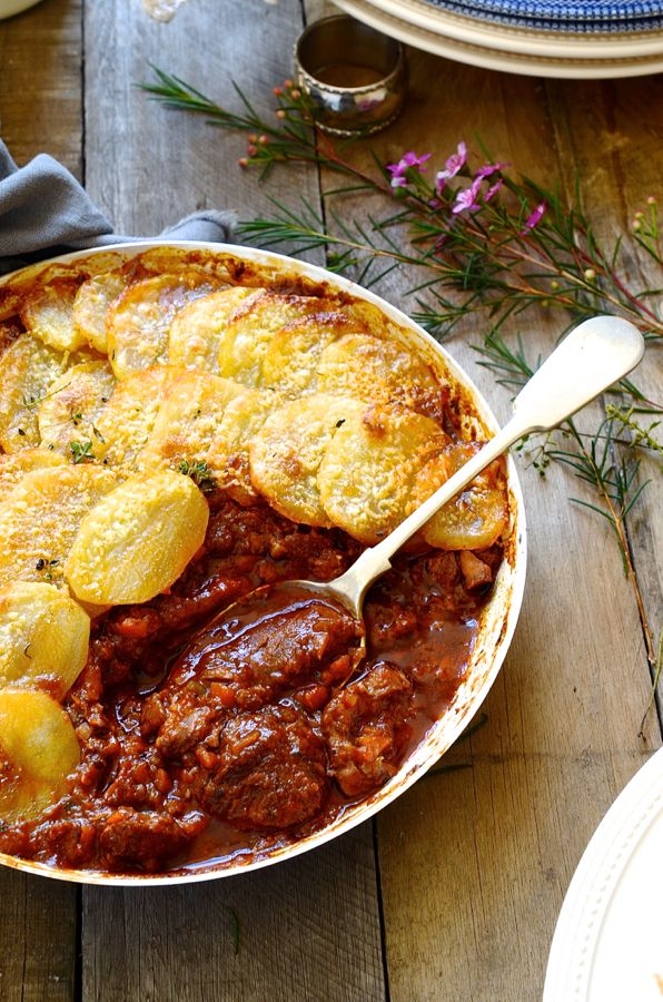 Red wine beef stew with potato gratin. Delicious winter recipes. Heart warming stew.