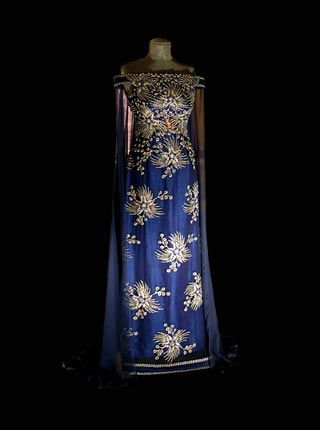 Worn by Queen Silvia 2002 A streamlined evening gown of marine blue silver-embroidered chiffon on a shift of bright blue Thai silk, with a chiffon train. Designed by Jørgen Bender, Copenhagen. Copyright © Nobel Media AB 2006 Photo: Frida Westholm