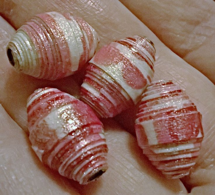 Pinner wrote: Paper beads I made with fancy napkin adhered to card stock and covered with a coat of iridescent medium before fully glazing.