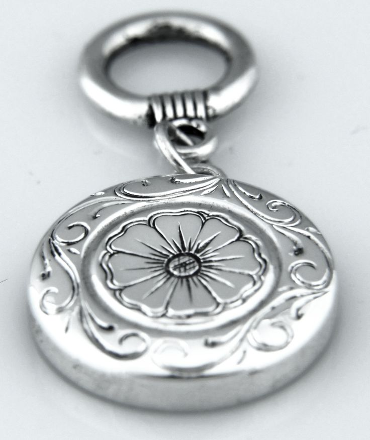 Pandora style flute key charm with engraving.