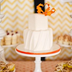 Two-tiered wedding cake with orange accents from 'A Bright Modern Wedding' in Pacific Palisades, CA.