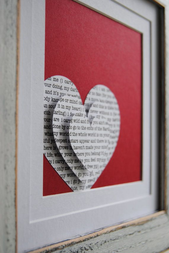 Favorite song lyrics in the shape of a heart -- Could also be SUPER cute in a nursery with lullaby lyrics in the shape of a star or something like that. Thank God for my Cricut!!