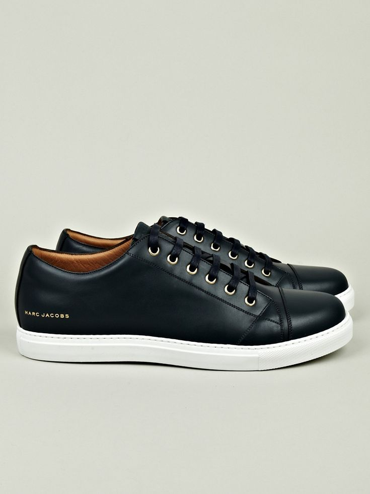 Marc Jacobs.  These are a step up from the black Nikes. I'd love some of these but I don't think they're affordable.