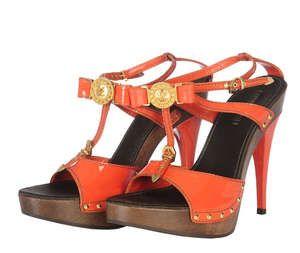 LOT:399   LOUIS VUITTON - a pair of patent orange leather platform sandals.