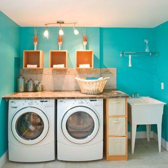 Even a laundry room can be bright! This fun teal colour complements the stainless steel washer and dryer ---------------------------------------- Même la buanderie peut être vive et amusante! Cette joyeuse nuance de sarcelle complémente à merveille les électroménagers en inox.