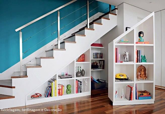 Suggested use of the area under the stairs. Interestingly, there is a secret space behind the visible shelves ... (: