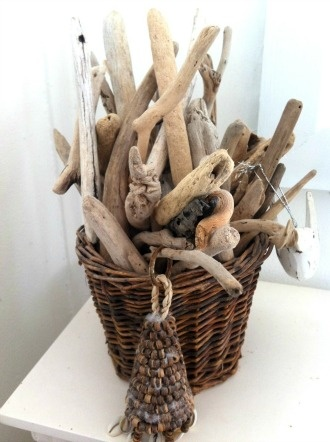 What a beautiful way of displaying all those gorgeous driftwood finds!
