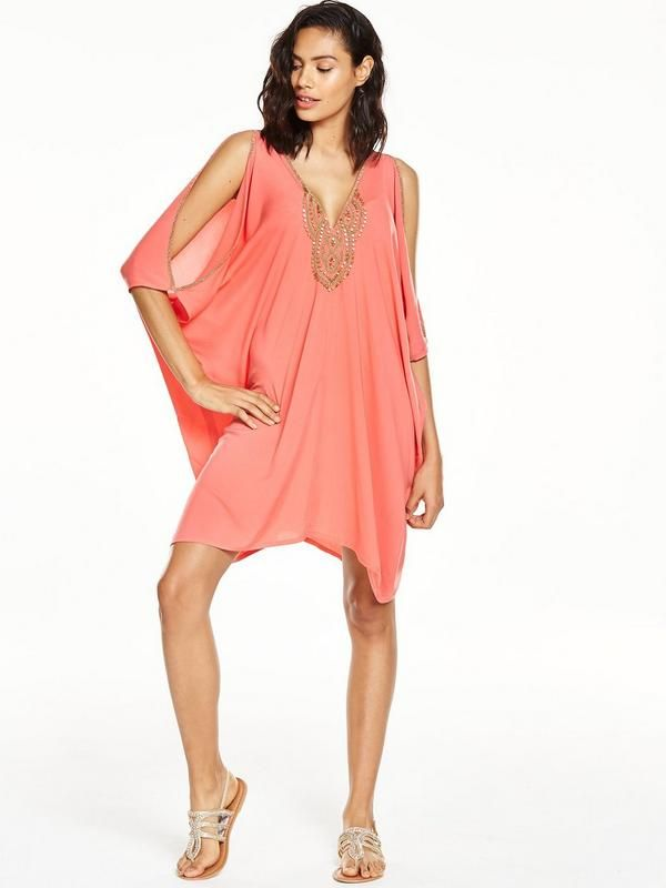 V by VeryEmbellished Batwing Beach Dress V by Very injects a touch of luxeinto your beachwear edit with thisbatwing dress. Its loose silhouette lends itself to layering easily over swimwear, while the V-neck cut and cold shoulder detailing promise to flatter your figure. With Grecian embellishments to the trims and neckline, what's not to love? Styling Ideas Available in bold coral or chic black, this piece looks perfect with a pair of strappy sandals.Washing Instructions: Machine…