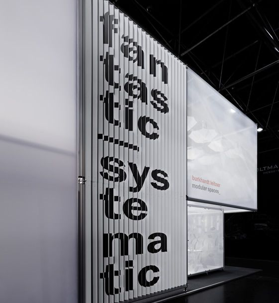 Burkhardt Leitner Exhibition Stand. Typographic statement on angled panels.