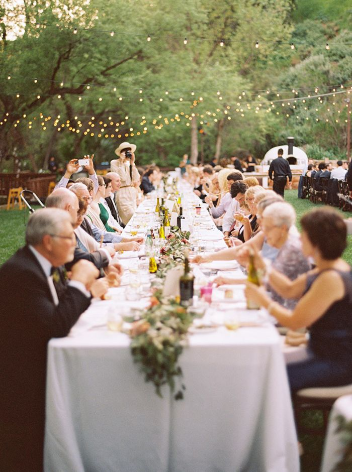 It's hard to argue with beautiful romantic string lights over a long table at an outdoor wedding!