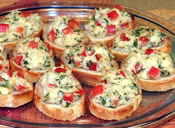 Miniature crunchy slices of bread baked with garlic olive oil, topped with a light and delicious mixture of flaky crab, red pepper, parsley and seasonings.