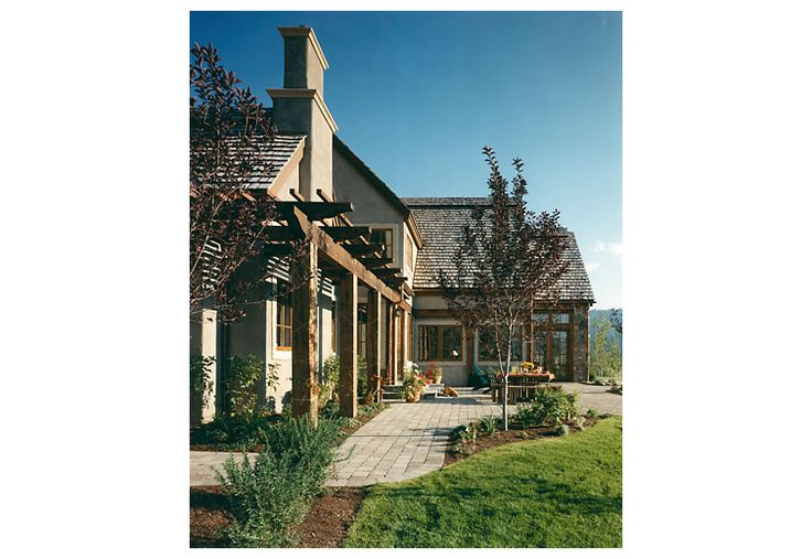 Another exterior shot of the terrace and trellis.  Traditional architecture with English country taste.  Recycled timber, stucco, stone, and other natural materials.