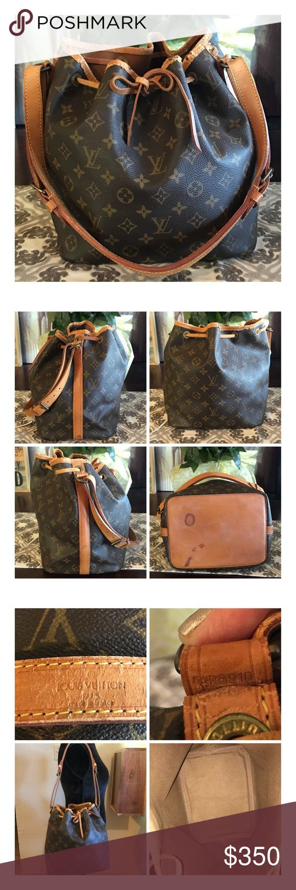 """Authentic Louis Vuitton Petite Noe 100% Authentic Louis Vuitton Petite Noe.   Monogram canvas has no scratches or tears.  Bottom shows signs of use but in good condition.  Leather has cracks but stitching is good.  Strap in good condition.  Leather rim has cracking see pics.  Inside is clean.  Will sell fast.  W9.44xH10.6xD7.08"""".  I do not trade. Louis Vuitton Bags Shoulder Bags"""
