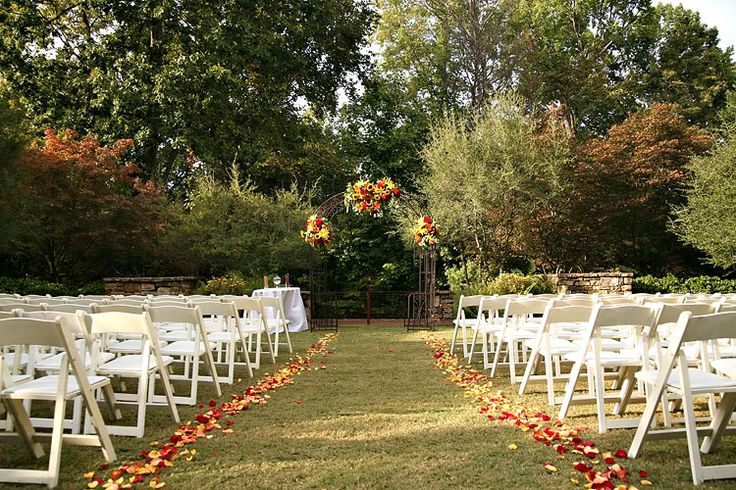 outdoor wedding petals along the isle