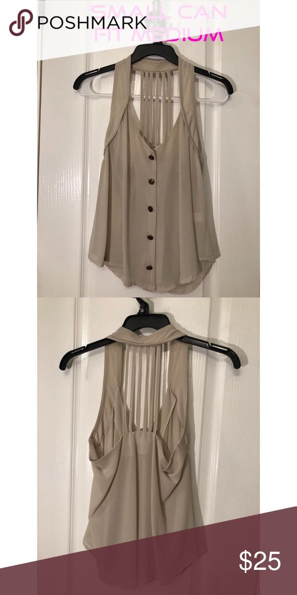 Beige strappy back button down blouse Very cute beige strappy back and button front. Flowy and can fit a medium also! Tops Blouses