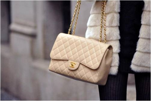 Chanel. <3 I love this one and the black one. When I am done with college and begin my career, I will own them.