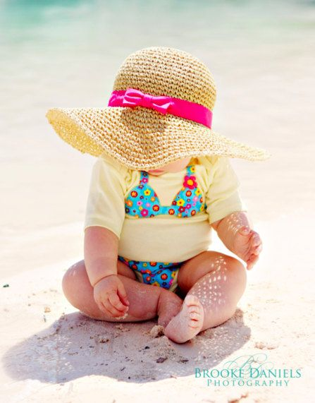 Oh my gosh. I've got to do this!! I have been looking for a newborn swimsuit, but HELLO they don't exist apparently. Since baby should stay covered up anyway, this will be PERFECT. How adorable.
