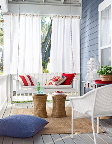 Great idea for a small back porch. Swing, curtains and little tables