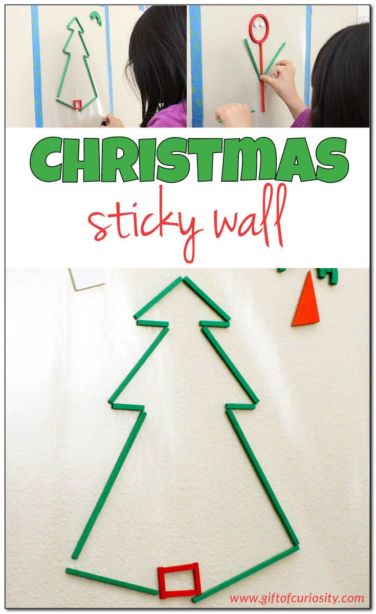 """Use a Christmas sticky wall to build creativity, fine motor skills, and visual spatial skills. This is a great open-ended Christmas """"craft"""" that kids can come back to again and again during the holiday season. 