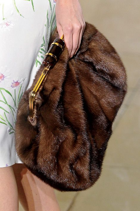 need this. oversized faux fur clutch...keeping an eye out at the thrift stores for material.