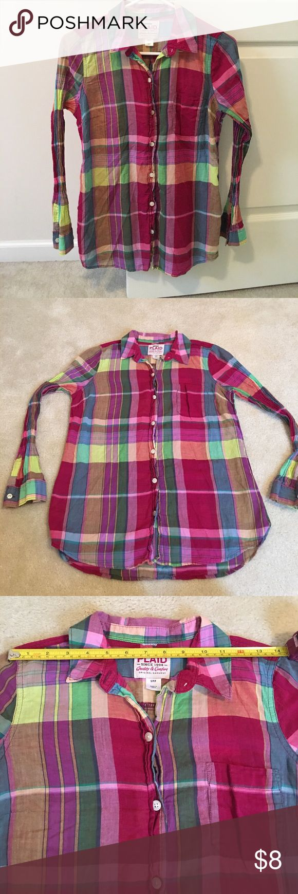 """Old Navy Plaid Checkered Long Sleeve Button Up Gently loved. Missing top button at collar as shown in second to last pic. Price reflects this. Front pocket. Accordion style sleeves that stretch (see last pic) with button cuff. Bright colors pretty for spring and fall. Measures 14"""" across from shoulder to shoulder, 18"""" across from arm pit to arm pit, and 25"""" long (in front) from top of shoulder to bottom hem (26"""" in back). Made of 100% Cotton. Has some stretch. Old Navy Tops Button Down…"""