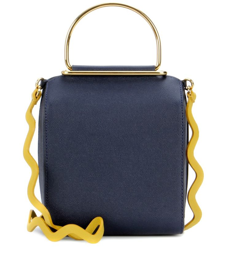 Roksanda - Besa leather shoulder bag - Crafted from grainy navy leather, Roksandra's leather shoulder bag features the designer's signature minimalist approach. The structured style features gold-tone handles and a detachable zigzag mustard yellow shoulder strap for a touch of colourful whimsy. Wear yours slung over the shoulder during the day, then use as a clutch for evening events. seen @ www.mytheresa.com