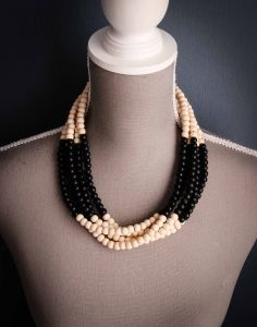 This Symmetrical Color Block Wooden Ombre Necklace is a multi strand wooden necklace color blocked using natural and black beads. Sold by www.wave2africa.com