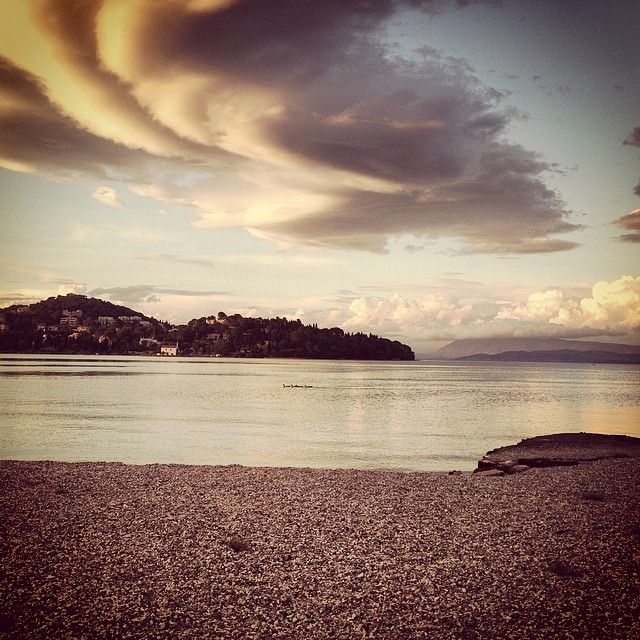 Taking a stroll by the #sea earlier today #clouds #view #sunset #corfu #saltybag #greece #beach #spring #may #sky #pebbles #evening #scenery