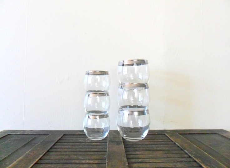 last minute 15% off sale mad men chic mismatched silver rim roly poly tumblers and shot glasses - midcentury modern  - don draper. $59.50, via Etsy.