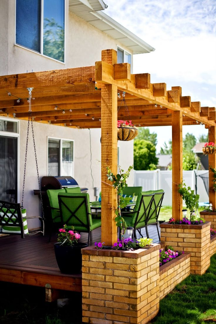 deck inspiration (deck, pergola, brick planters, grape vines, swing seat)