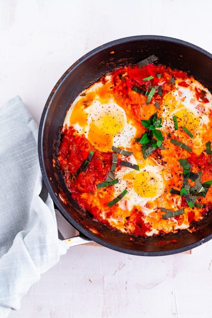 Shakshuka Poached eggs in a spicy tomato sauce, served