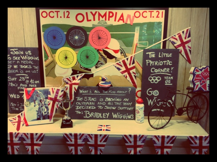 The Spirit of Geronimo: Day Ten     Getting involved! Sport has always been important to us, if not necessarily the taking part then the watching of it at least. From the Six Nations to the boat race to the big football fixtures. During the Olympics last year all our pubs supported a Team GB athlete by creating a shrine to their chosen Olympian. Here is the Five Tuns shrine to Bradley Wiggins.