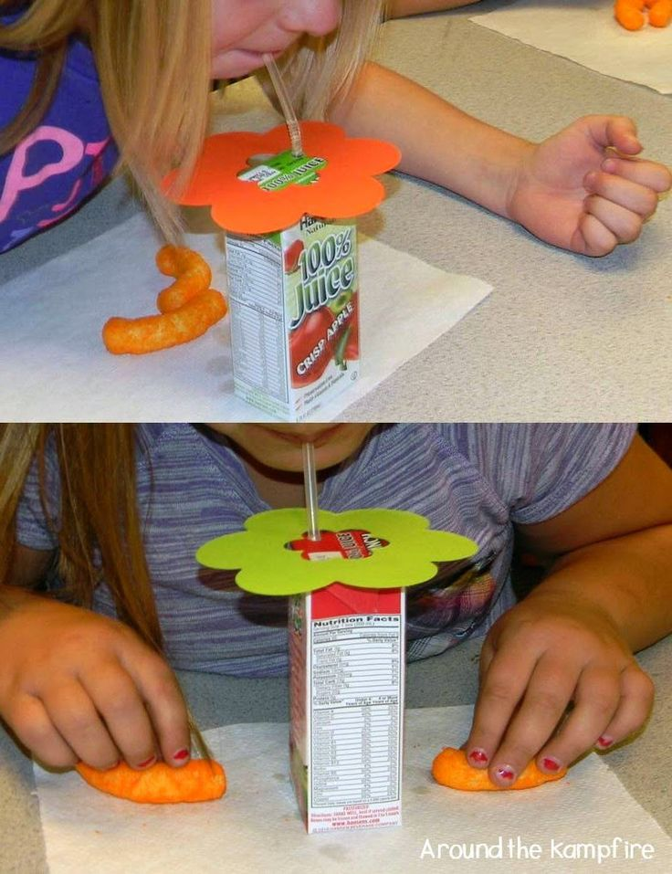 "Teaching pollination:  Student ""bees"" drink the ""nectar"" (juice boxes).  They have to put their ""feet"" (hands) on the Cheetos while they do it.  The cheese coating comes off just like pollen!"