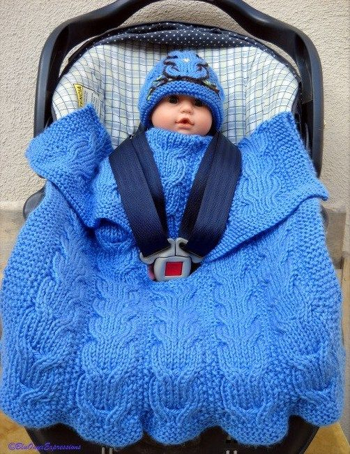 Knitting Pattern Reversible Cable Car Seat Baby Blanket - This a reversible blanket knit with Double Cable, Seed and Garter stitches features a multi-point harness slit knit into the blanket so that your blanket will stay in place covering your little one, without bunching up.
