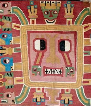 This image shows a fragment from a Huari-style ceremonial panel from Peru, dating from A.D. 750 to 800. The tapestry shows a fierce-looking deity with rays coming out of his head.