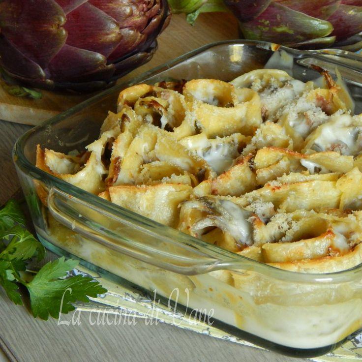 Nidi di lasagne con carciofi salsiccia e scamorza