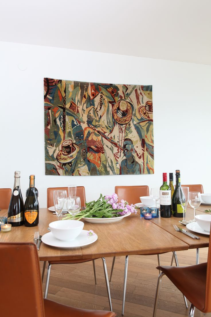 "Ehi Obinyan's rug ""Eyo Festival"" provides an exciting backdrop in the dining space. #rug #interior Check out our website for more of our collection.. http://africaonthefloor.com/"