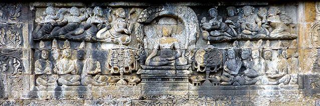 """The Bodhisattva attains Awakening and becomes the Buddha"" (detail), a Lalitavistara (The Life of the Buddha)    relief at Borobudur in Java, Indonesia, 9th century."