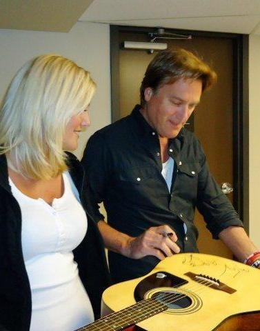 Michael W Smith signs a guitar in Calgary