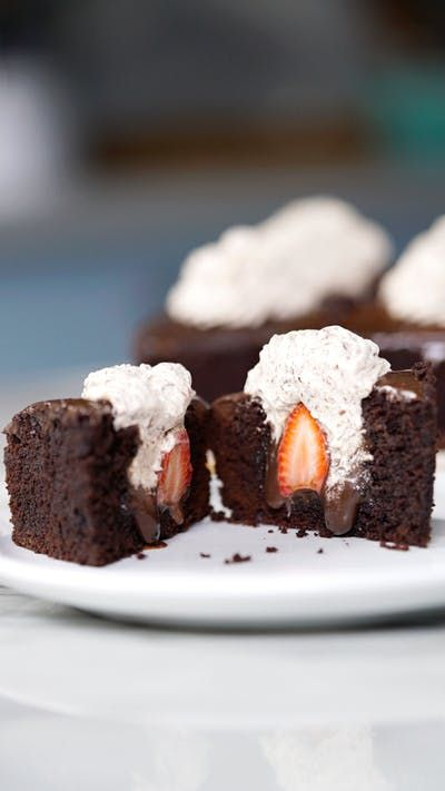 Moist, chocolatey brownies topped with chocolate sauce and filled with cream pack a strawberry surprise.