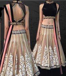 designer chiku lahena choli with comes black velvet blouse, lahenga has 5 meter gher in net febric with embroidary work and velvet lace belt and sattin inner , dupatta has 2.50 meter pink net..