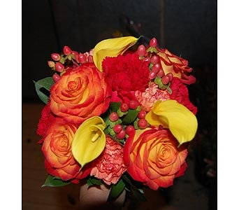 Hand tied bouquet of Circus roses, red and orange carnations, yellow mini callas, hypericum berries.