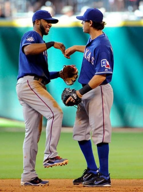 IAN AND ELVIS ;)Players Of Texas Rangers Doing Fun During The Game. -- I <3 Elvis!