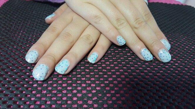 Light blue nail polish with glitter