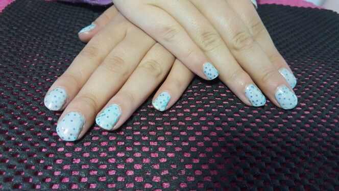 Light blue nail polish with glitter